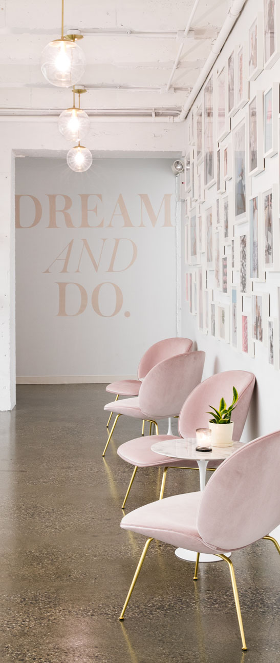 lobby with chairs and text that reads dream and do